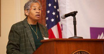 Deborah Watts speaking at a podium