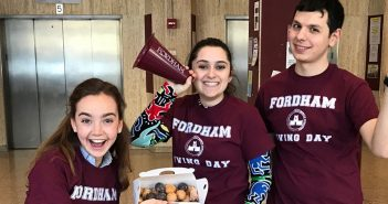 "Three students wearing maroon shirts that say ""Fordham Giving Day"""