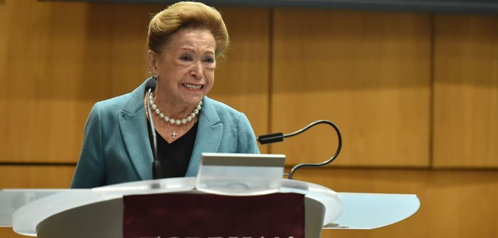 Mary Higgins Clark standing at a podium