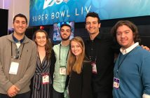 Students pose at Radio Row