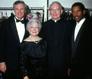 Father O'Hare at a formal Fordham event with Helen Hayes, Alan Alda, and Denzel Washington