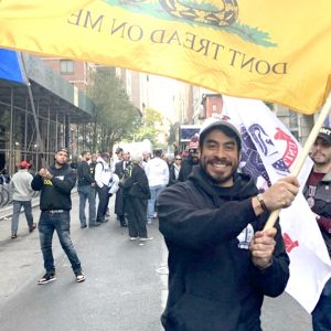 Matias Ayala, SVAF's new president, marches with group at the Veteran's Day Parade last November.