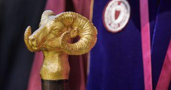 A golden ram head statue on a stick