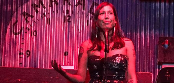 Melissa Castillo Planas on stage during a book presentation