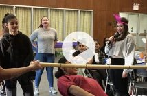 Students play limbo.