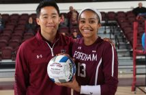 Volleyball coach poses with player