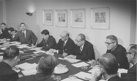 John Feerick sitting at a table alongside then senator Birch Bayh