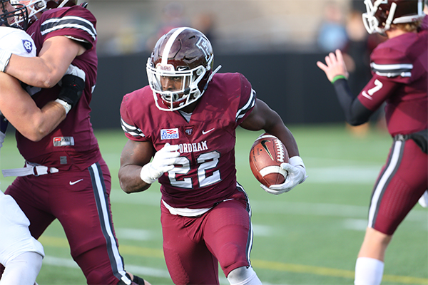 Chase Edmonds runs the ball for Fordham