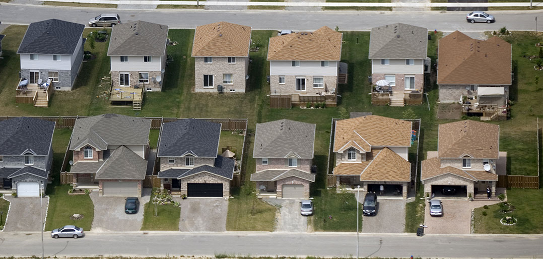 stock image of houses in a suburb