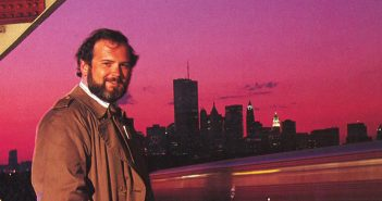 A man stands in front of the New York skyline in 1991