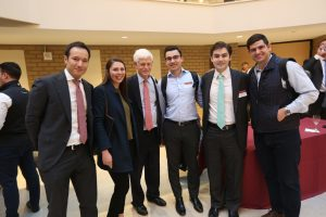 Mario Gabelli standing with students
