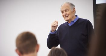 Alan Alda speaking in front of a class
