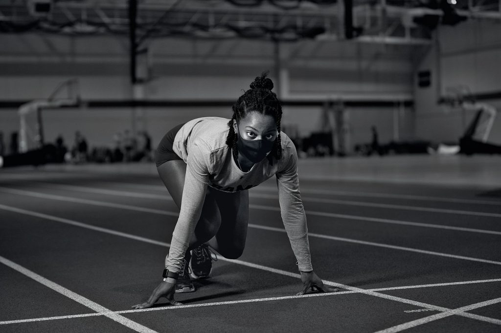 A girl lines up to run before track