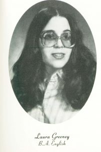 A black and white yearbook photo of a woman wearing glasses