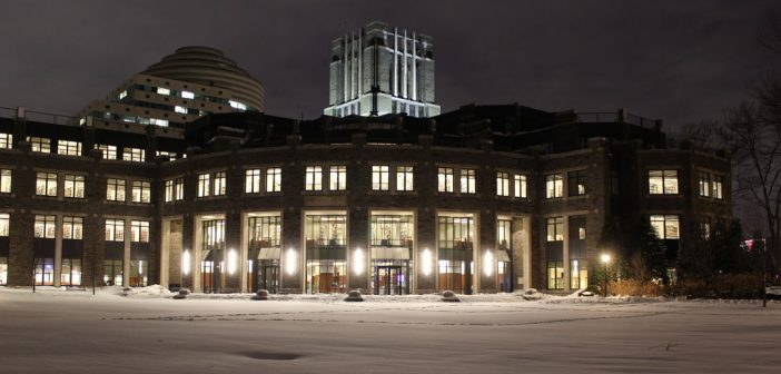 Walsh Library lit up on snowy night