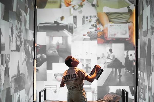 "Elijah Lancaster in Jeremy McQueen's ""WILD: Act 1."" Photo by Matthew Murphy."