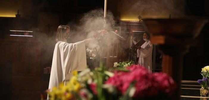 Dispersing incense in University Church, with smoke