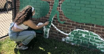 Students Work with Bronxites to Paint Community Mural