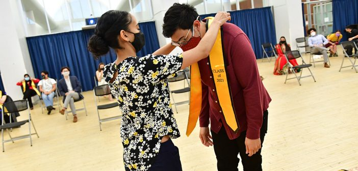 Student receiving yellow stole at AAPI graduation celebration