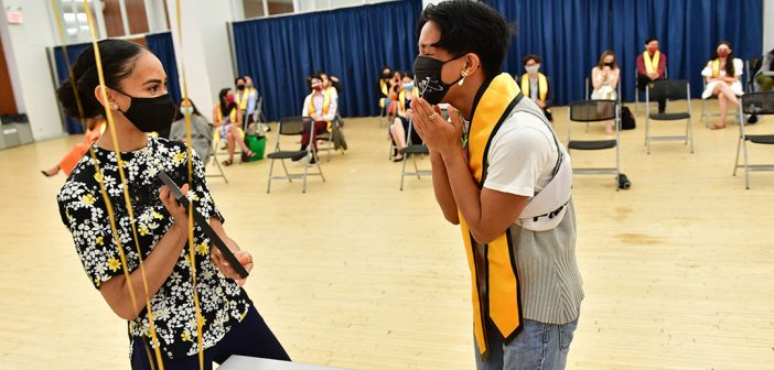 Student with yellow stole at AAPI graduation celebration
