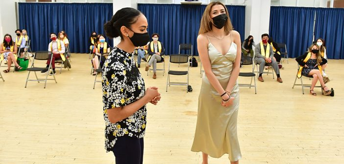Student with log white dress at AAPI graduation