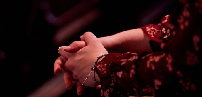 close up of hands folded together
