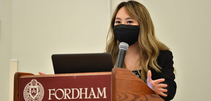 Student speaking at podium at AAPI graduation