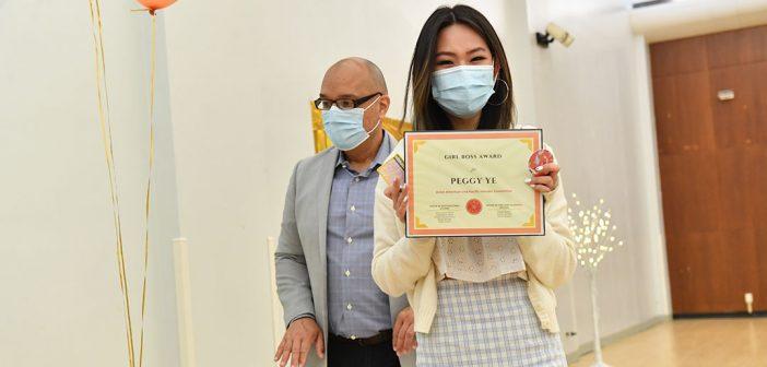 Student holding diploma at AAPI graduation