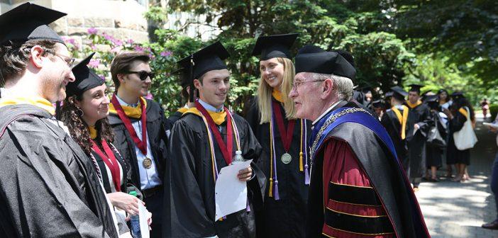 FAther McShane talking to Gabelli School grads