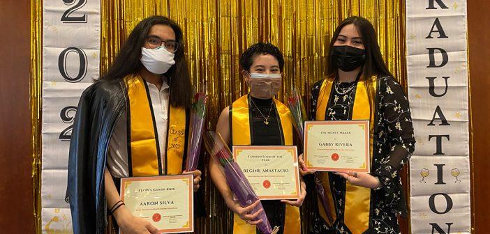 Students with yellow stoles and diplomas at AAPI graduation