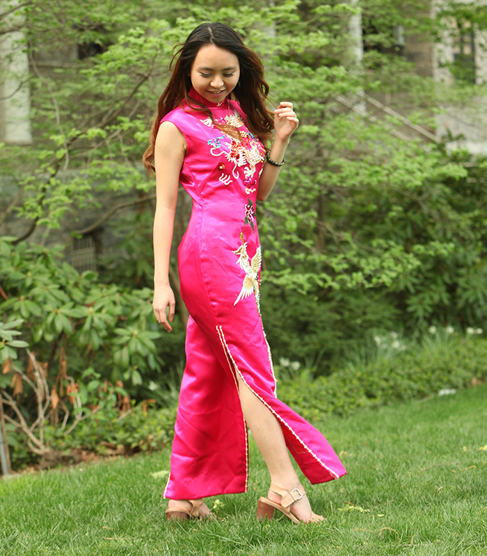 Angela Ly wears her mother's wedding dress, a traditional qi pao in silk with an embroidered phoenix and dragon.