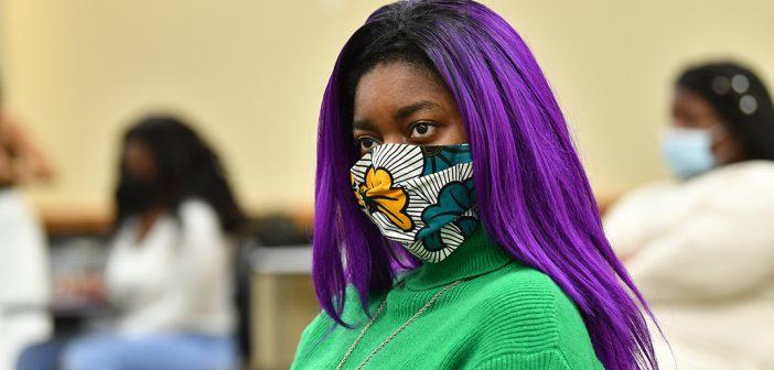 Student with purple hair at Black graduation celebration