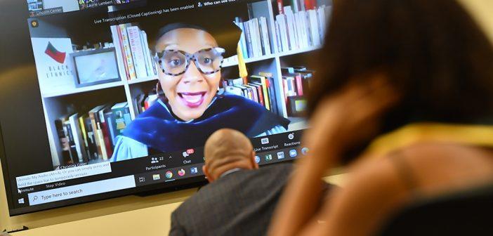 Professor Christina Greer at Black graduation celebraiton on screen