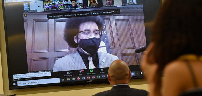 Juan Carlos Matos on screen at Black graduation celebration