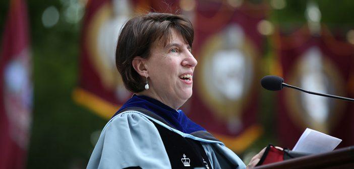 Dean Laura Auricchio at podium