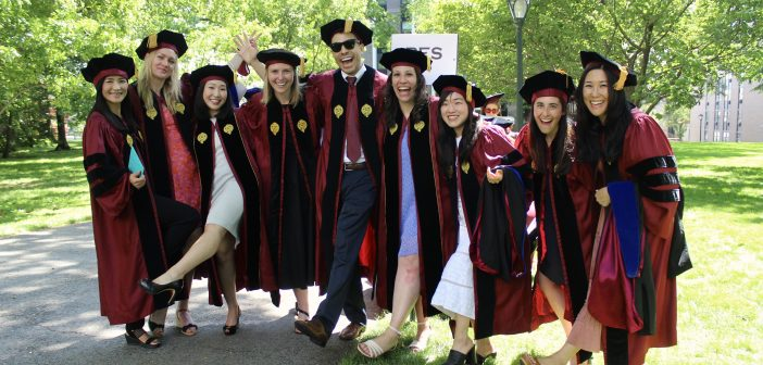 A group of GSE graduates posing together.