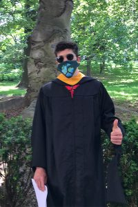 Brandon LaBella, a 2021 GSE graduate, posing with trees in the background.
