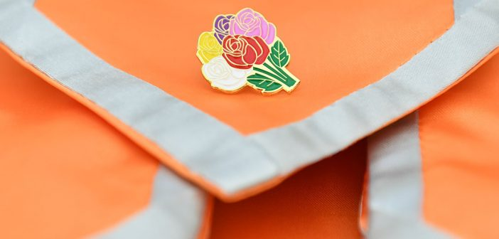 Orange stole with fower pin