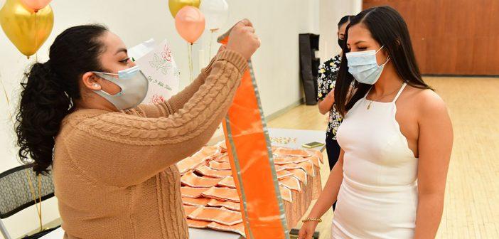 Graduate receiving orange stole at Latinx graduation