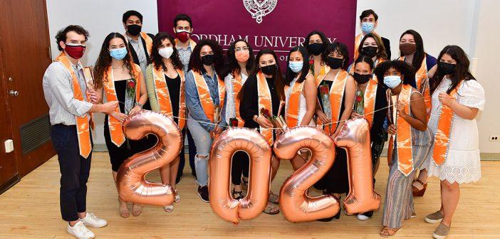 Graduate rewith orange stoles at Latinx graduation