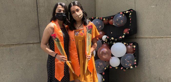 Graduates with orange stoles and balloons at Latinx Graduation