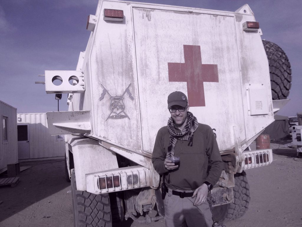 Ray Mitchell standing in front of a Red Cross truck