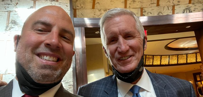Mike Breen, FCRH '83 (right), posing with Fordham athletic director Ed Kull at the 2021 Basketball Hall of Fame Curt Gowdy Award ceremony.