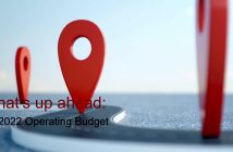 "An oversized red location logo above the words ""What's up ahead: FY 2022 Operating Budget"""