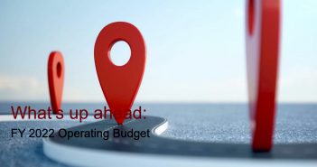 """An oversized red location logo above the words """"What's up ahead: FY 2022 Operating Budget"""""""
