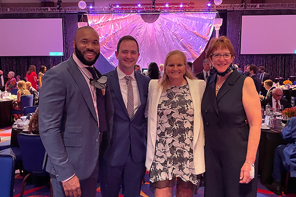 From left to right: Fordham men's basketball head coach Kyle Neptune; Andrew O'Connell, FCRH '12; Fordham women's basketball head coach Stephanie Gaitley; and Anne Gregory-O'Connell, FCRH '80, attend the Basketball Hall of Fame induction ceremony.
