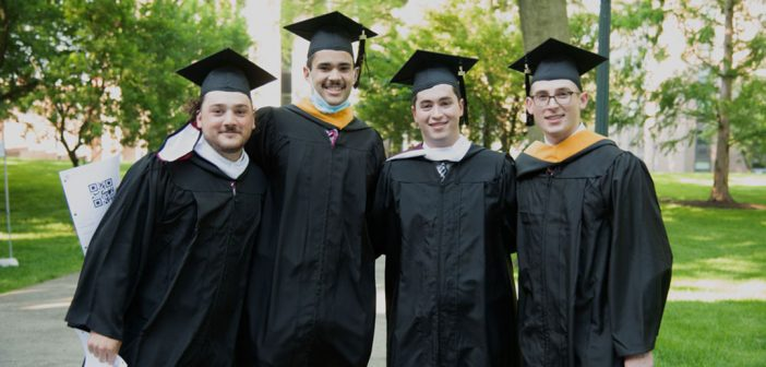 Men grads in caps and gowns--rugby players