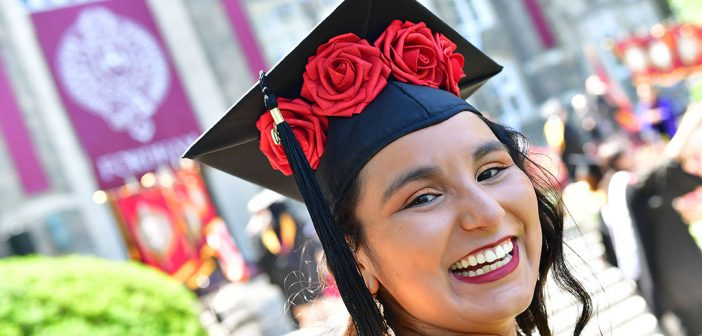 close up of a woman graduate with flowers on her cap