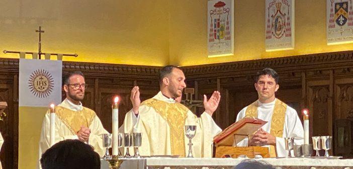 Michael Lamanna, SJ, standing at the altar