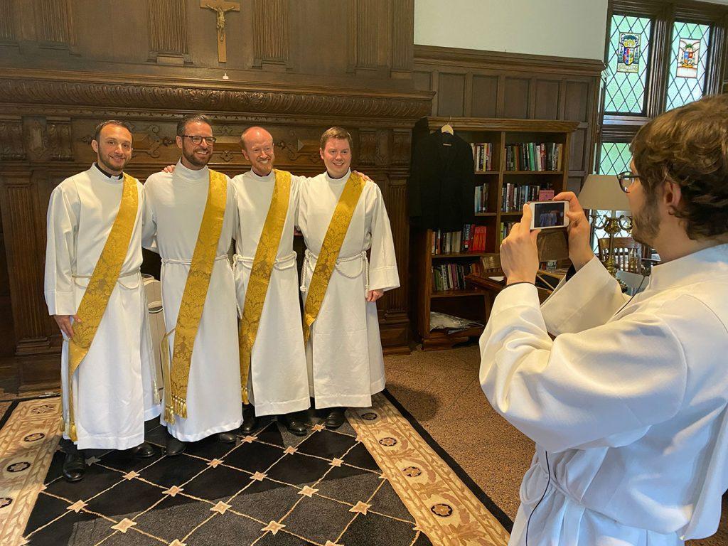 Michael Lamanna, SJ, Zachariah Presutti, SJ, Daniel Gustafson, SJ and William Woody, SJ posing for a group pho